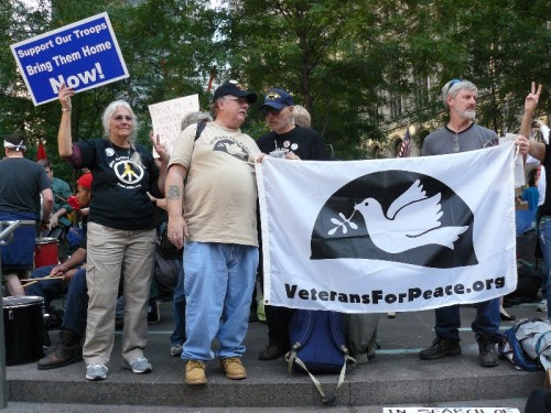 Ken Dalton (center) holds VFP banner at Wall St. protest